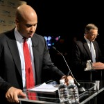 Newark Mayor Cory Booker and Rep. Rush Holt (background) prepare for the US Senate Democratic Primary Debate hosted by NJTV at Montclair State University on August 5, 2013. (NJTV/Joe Sinnott)