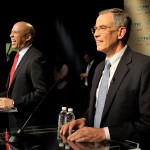 Rep. Rush Holt and Newark Mayor Cory Booker (background) share a laugh at the US Senate Democratic Primary Debate hosted by NJTV at Montclair State University on August 5, 2013. (NJTV/Joe Sinnott)
