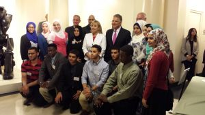 Steve Adubato and Acting Gov Kim Guadagno smile with student honorees.